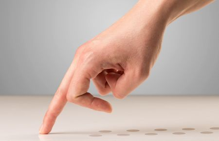 Female fingers walking with dots behind them
