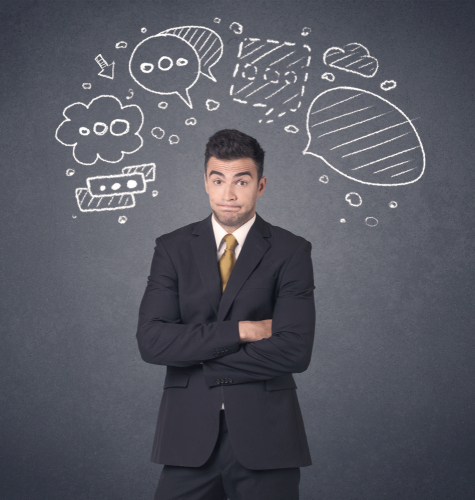 Young businessman with drawn speech bubbles over his head