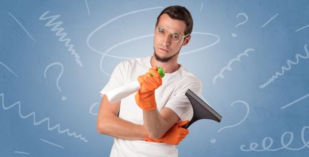 Swabber with orange rubber gloves and doodle concept on wallpaper
