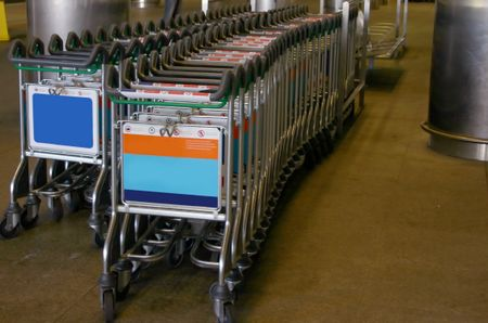 Trolleys by the railway at an airport