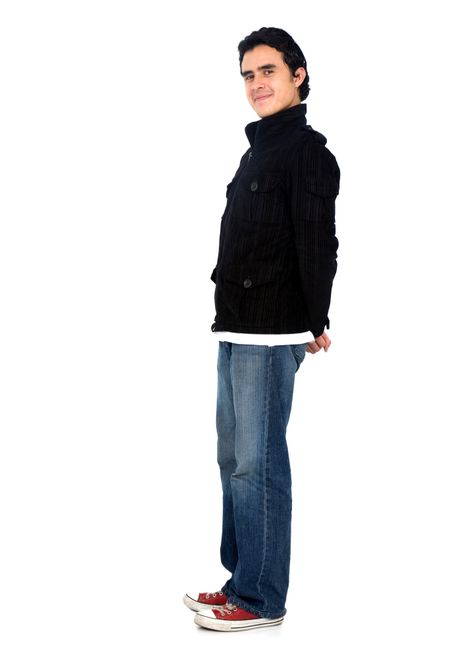 Casual friendly man in blue jeans standing – isolated over a white background
