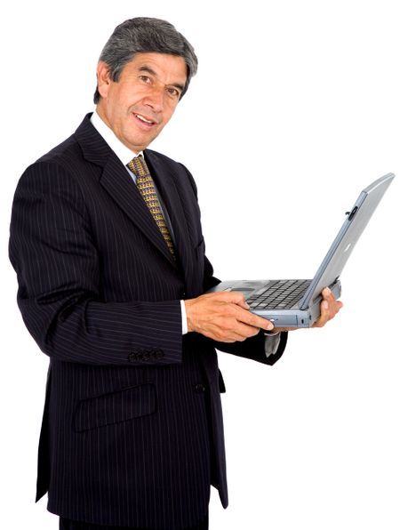 business man on a laptop smiling - isolated over a white background