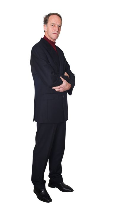 confident business man standing with his arms crossed