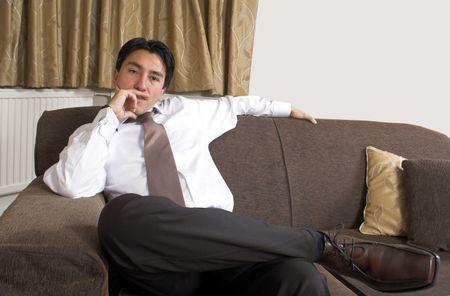 business man sitting on a sofa
