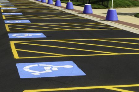 Parking spaces reserved for the disabled in outdoor lot for the public