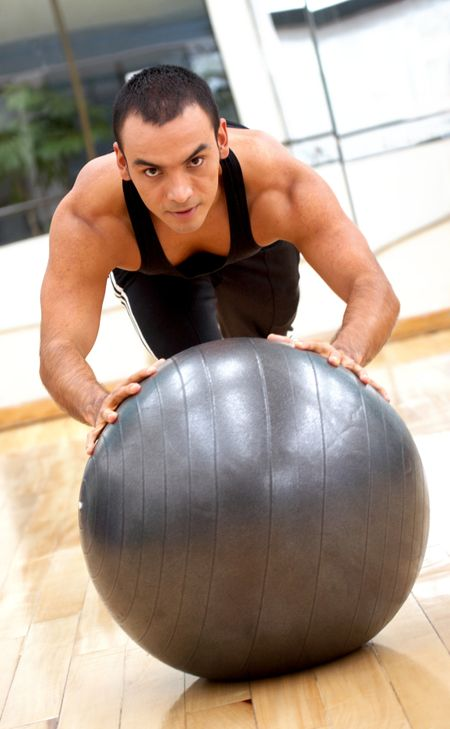 fitness male doing pilates exercises at the gym