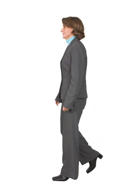 business woman walking from right to left