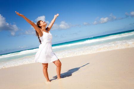 Beautiful woman enjoying her holidays at the beach