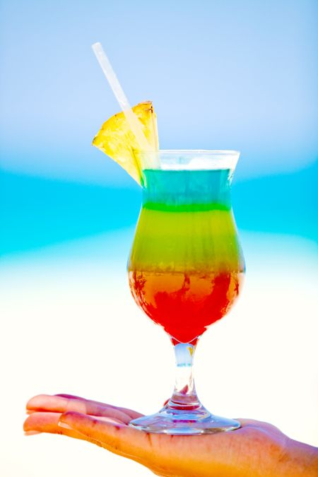 Colorful tropical cocktail looking very provocative at the beach