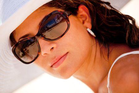 Beautiful woman portrait wearing sunglasses and a hat