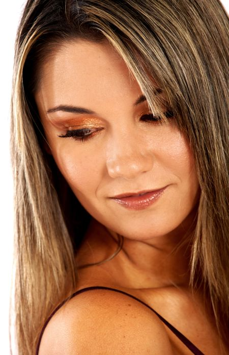 casual woman portrait wearing make up looking over her shoulder with a pensive face