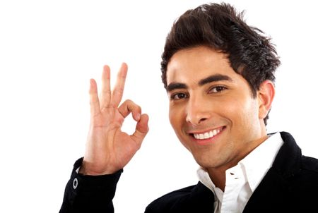 business man smiling doing the okay sign over a white background