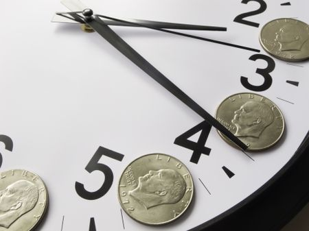 Concept of time is money: Eisenhower dollar coins on face of analog clock