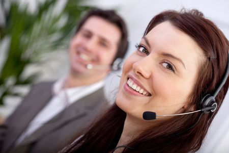 Woman with a headset in a call center