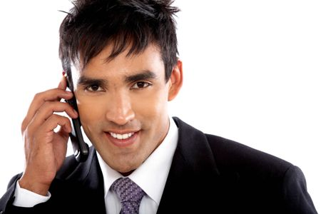 Business man on the phone smiling - isolated over a white background