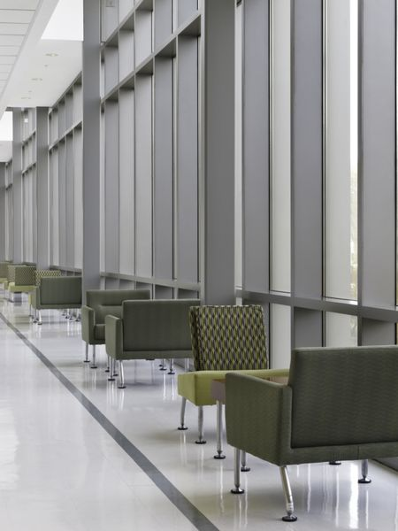 """Chairs in pairs by windows along """"lounge lane"""" of hallway at community college"""
