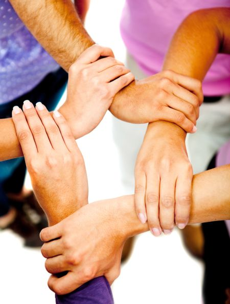 Group of people holding hands - teamwork concepts