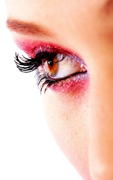 beautiful female eye with make up isolated over a white background
