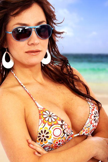 bikini fashion woman portrait wearing sunglasses at the beach