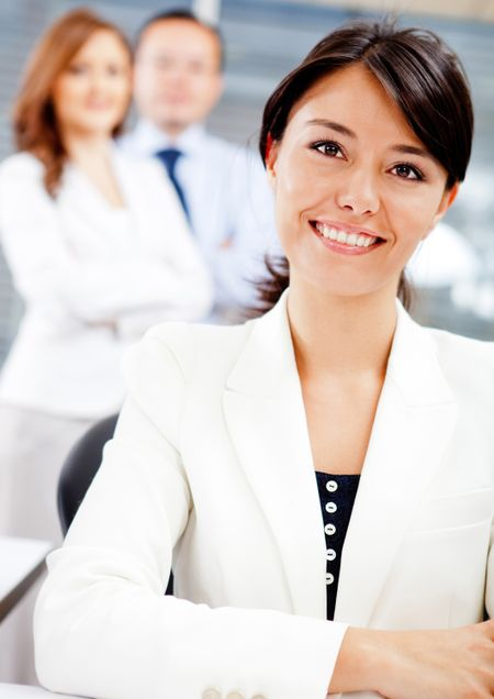 Beautiful business woman at the office smiling