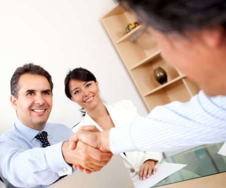 Business people closing a deal with a handshake