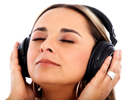 girl listening to music looking happy over white