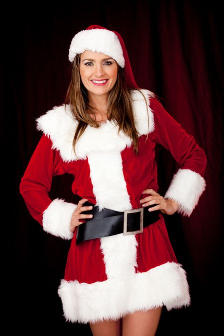 Female Santa looking very sexy in a short outfit
