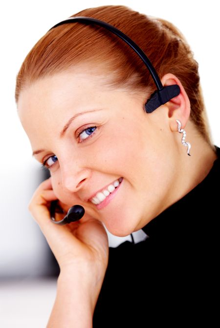 business customer service woman smiling wearing a headset in her office