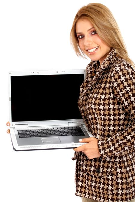 Business woman displaying a laptop computer - isolated over a white background
