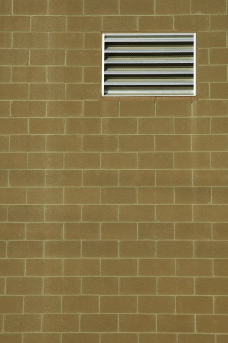 Abstract realism: Vent in exterior brick wall of building