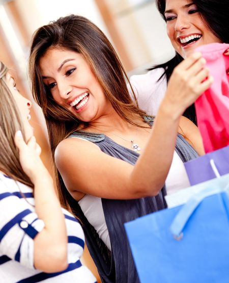 Happy female friends shopping at a retail store