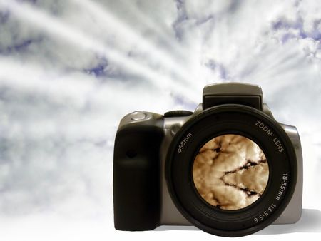 Digital SLR showing a red sky on lense with a blue sky at the background including some light rays