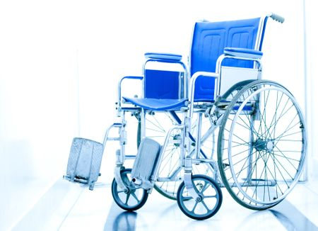 Wheelchair at the entrance of a hospital over a white background