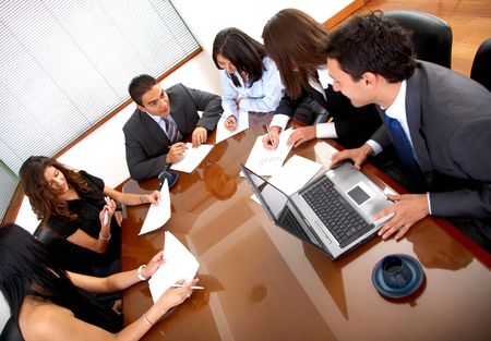 business meeting in an office with businessmen and businesswomen