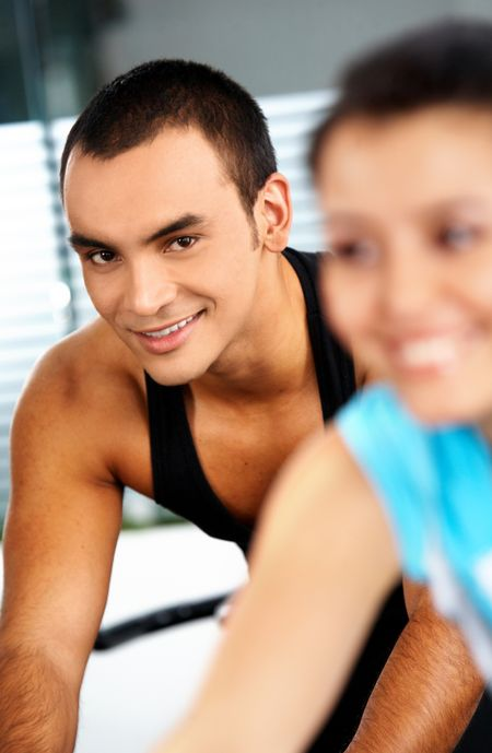 man and woman at the gym working out