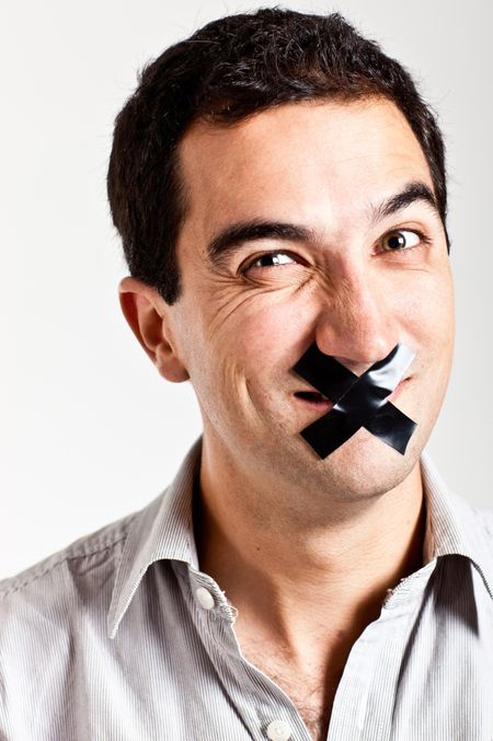 Man struggling to keep quiet with a tape in his mouth