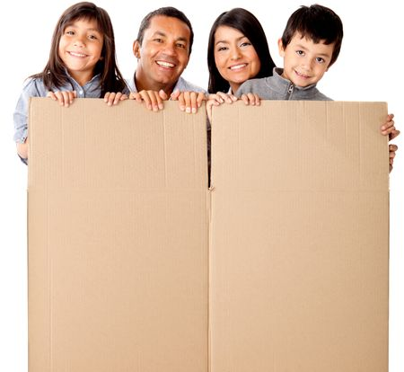 Family packing in cardboard box for the moving - isolated over a white background