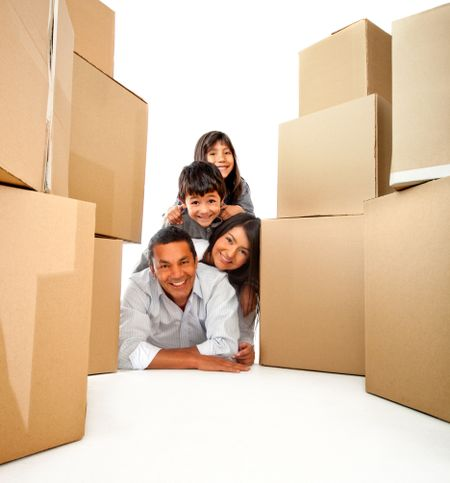 Family moving house with cardboard boxes - isolated over a white background