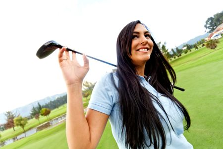 Beautiful woman playing golf at the club