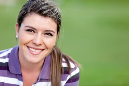 Beautiful woman portrait smiling outdoors looking very happy