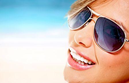 Beautiful woman wearing sunglasses on a summery day