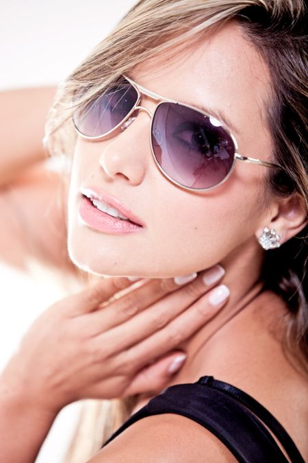 Sexy woman wearing sunglasses - isolated over a white background