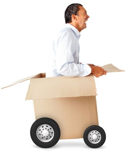 Man in a car made of cardboard box - fast delivery concepts