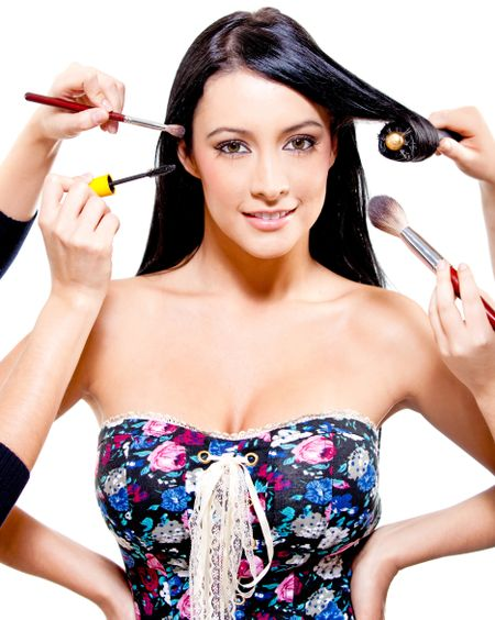 Woman getting professional hair and makeup styling - beauty concepts