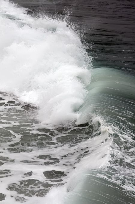 Wave crashing toward shore