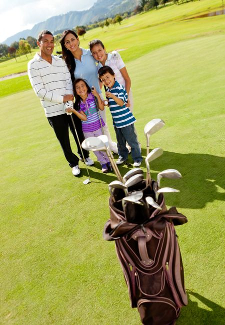Family at the golf field looking happy