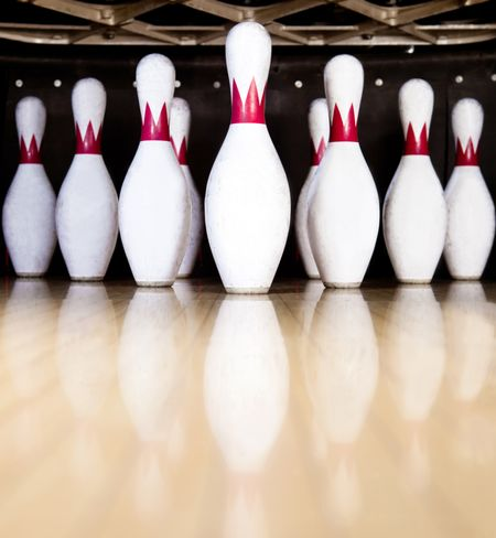 Ten white pins in a bowling alley