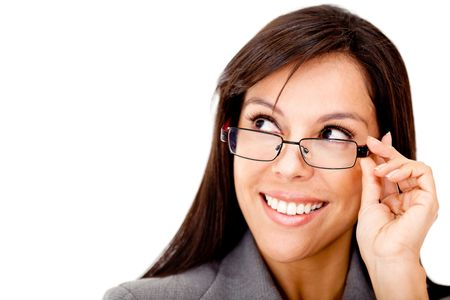 Clever business woman with glasses looking to the side - isolated over a white background