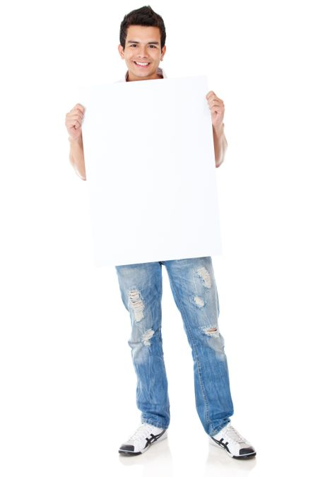 Casual man standing and holding a banner - isolated over white
