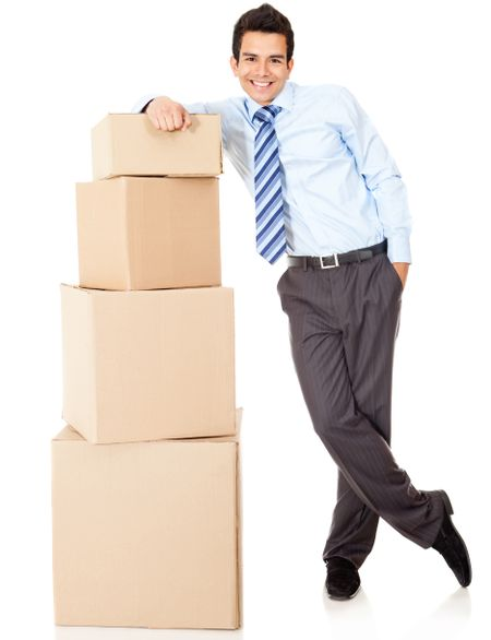 Businessman packing in carton boxes and getting ready for moving - isolated